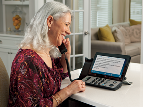 Senior Woman using CapTel Phone
