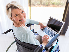 Middle Aged woman in a wheelchair on a laptop