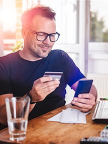 Man using phone to buy items