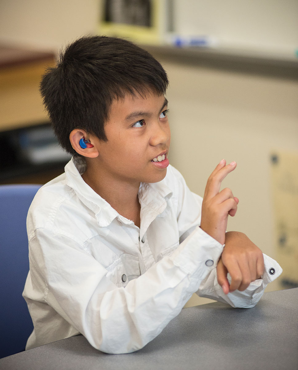Boy speaking with sign language