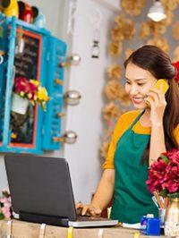 Flower girl taking an order on phone